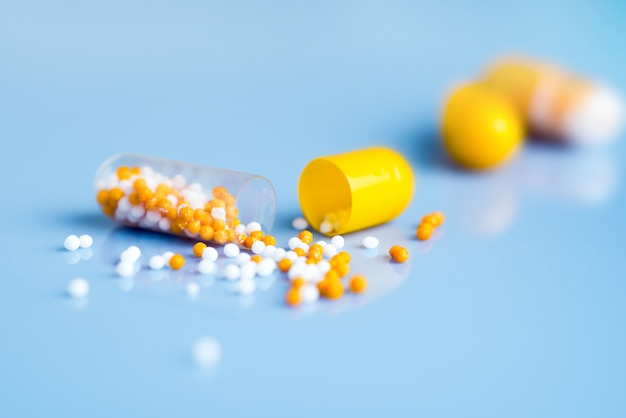 Yellow capsules on blue