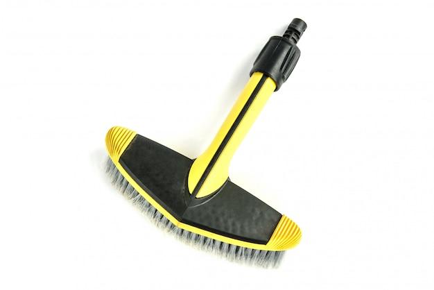 Yellow car brush for washing isolated on white background