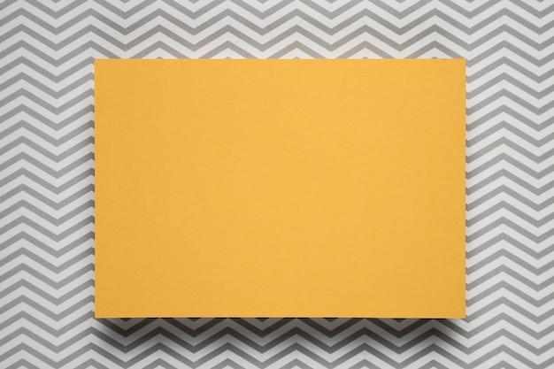 Yellow card with patterned background
