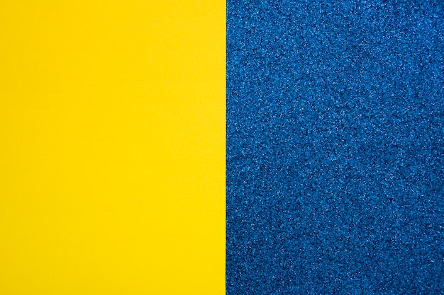 Yellow cardboard paper on blue carpet