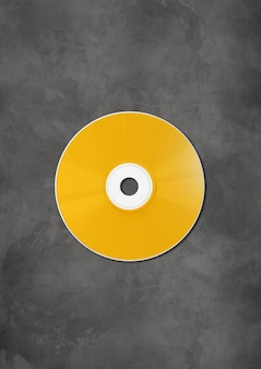 Yellow cd  dvd label mockup template on concrete