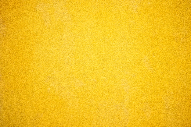Yellow cement or concrete wall texture for background