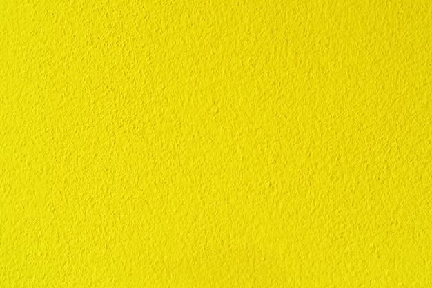 黄色のセメントまたはコンクリートの壁のテクスチャの背景。