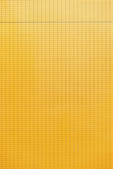 Yellow ceramic wall background.