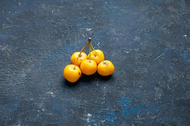 Yellow cherries isolated on dark desk