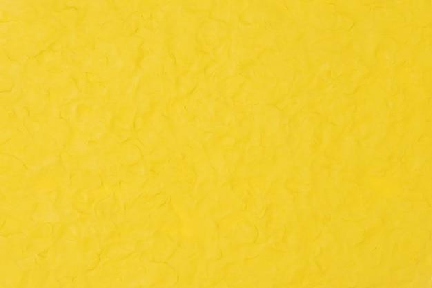 黄色い粘土のテクスチャ背景カラフルな手作りの創造的な芸術の抽象的なスタイル