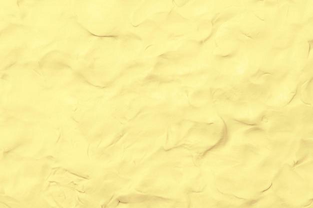 L'argilla gialla ha strutturato lo stile astratto dell'estratto di arte creativa fatta a mano variopinta del fondo