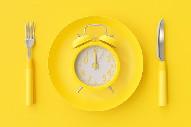 Yellow clock on the yellow plate