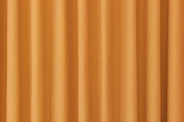 黄色の閉じたカーテンの背景の極端なクローズアップ。