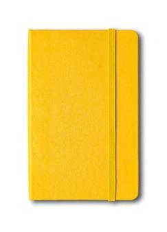 分離された黄色の閉じたノート