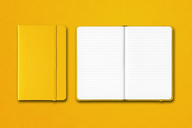 Yellow closed and open lined notebooks isolated