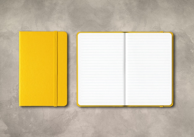 Yellow closed and open lined notebooks mockup isolated on concrete background