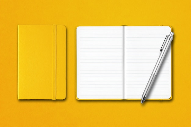 Yellow closed and open lined notebooks with a pen isolated