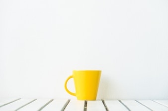 Yellow coffee cup on table