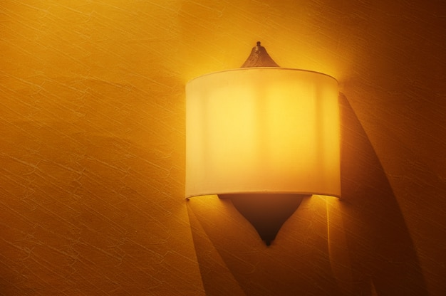Yellow color background with lighting bulb on the wall