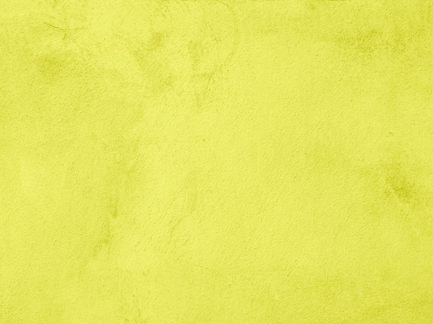 Yellow color cement and concrete texture for abstract background.