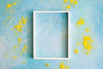 Yellow color powder around the white border frame on painted wall