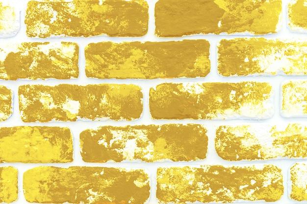 노란 색된 벽돌 벽 배경 가까이