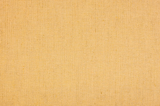 Yellow colored seamless linen texture or fabric canvas background.