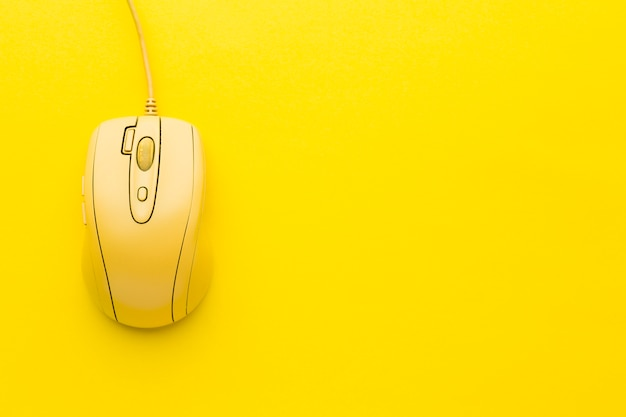 Yellow computer mouse copy space