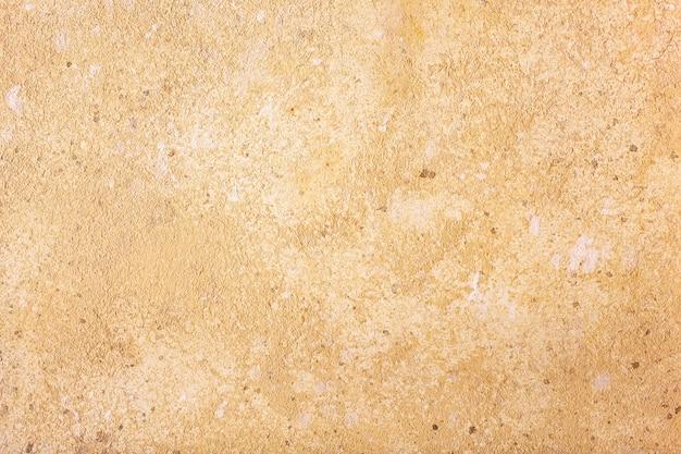 Желтая предпосылка текстуры бетонной стены.