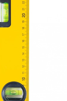 Yellow construction bubble spirit level isolated on a white background