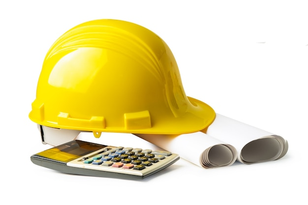 Yellow construction helmet and calculator isolated on white background