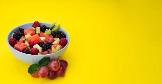 Yellow copy space background with fruit salad