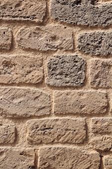 Yellow coquina bricks wall. shell rock brick wall