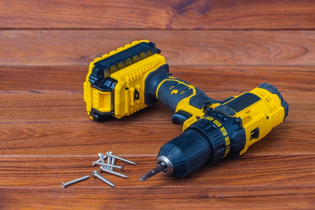 The yellow cordless battery powered drill