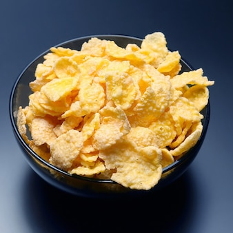 Yellow corn flakes in a bowl. flour food