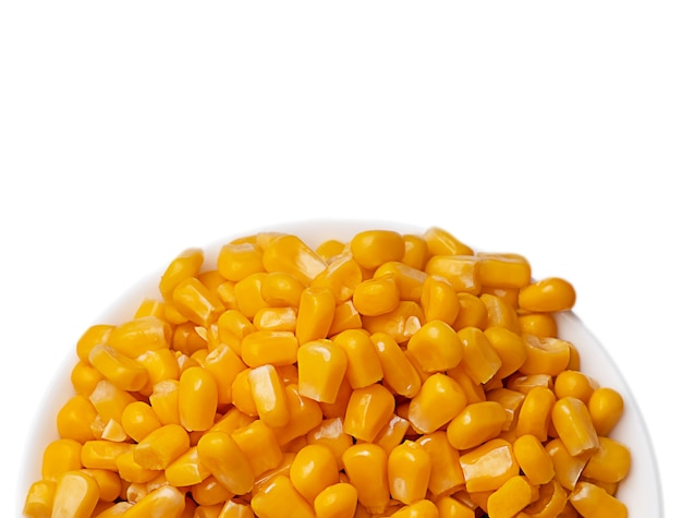 Yellow corns over white background.