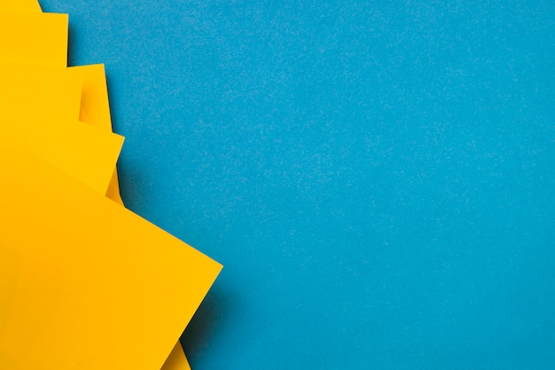 Yellow craftpapers on blue backdrop