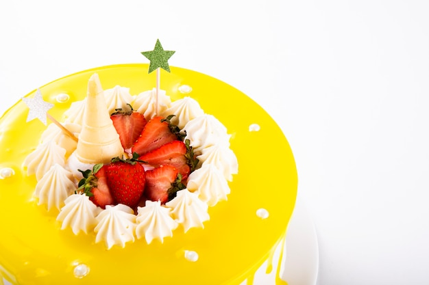 Yellow cream cake decorated with fresh strawberry fruit