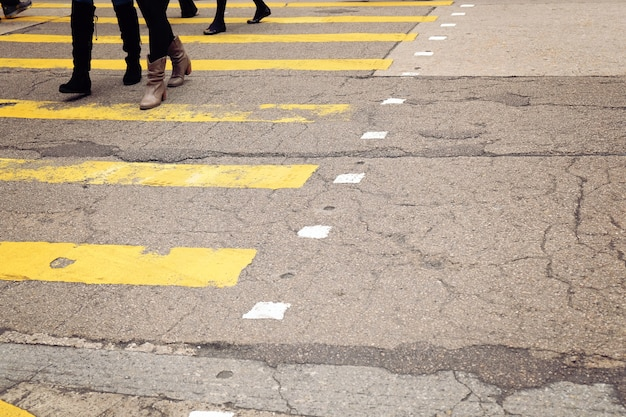 Yellow crossroad with walking pedestrians