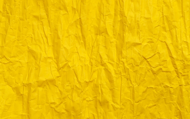 Yellow crumpled paper texture, color grunge