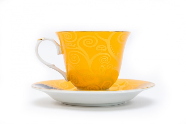 Yellow cup of tea on white background. isolated on white