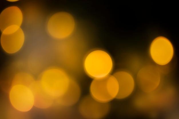 Yellow defocus lights on black background
