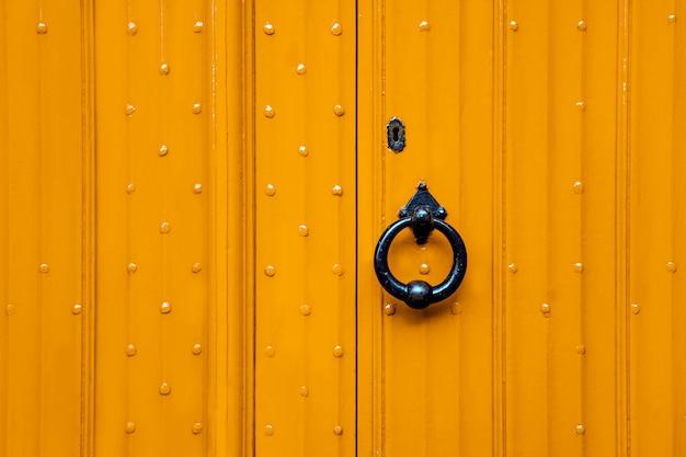 Yellow door and black handle