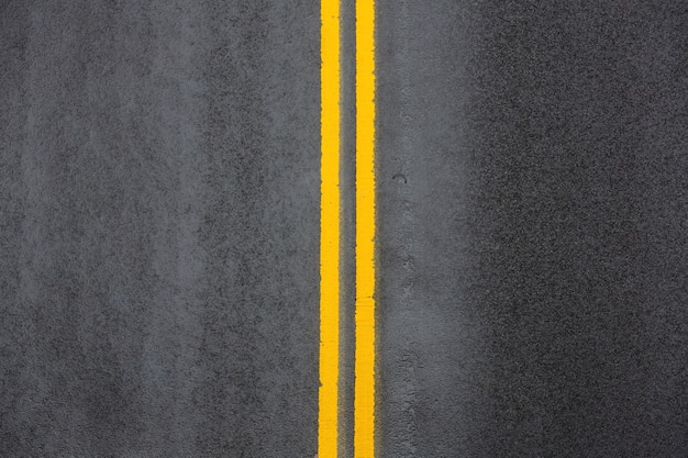 Yellow double solid line. road markings on asphalt on the street of manhattan in new york city
