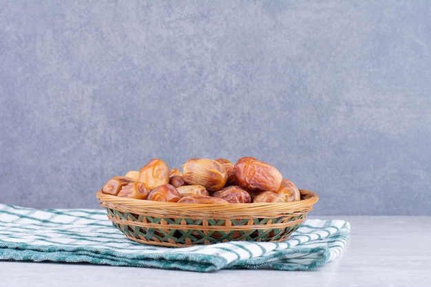 Yellow dry dates on a wooden platter. high quality photo