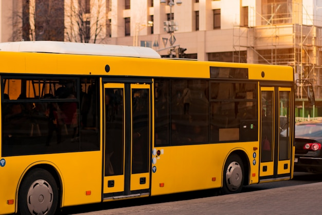Yellow electric bus in the city. zero emissions. alternative energy