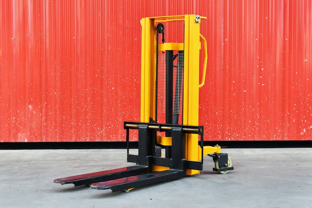 Yellow electric forklift in the warehouse front