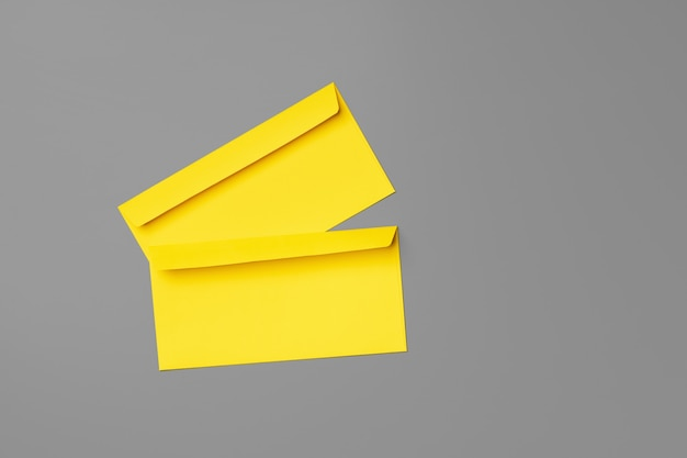 Yellow envelope on gray background copy space