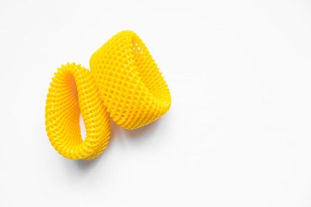 Yellow epe fruit nets close-up isolated. expanded polyethylene foam mesh for fruit