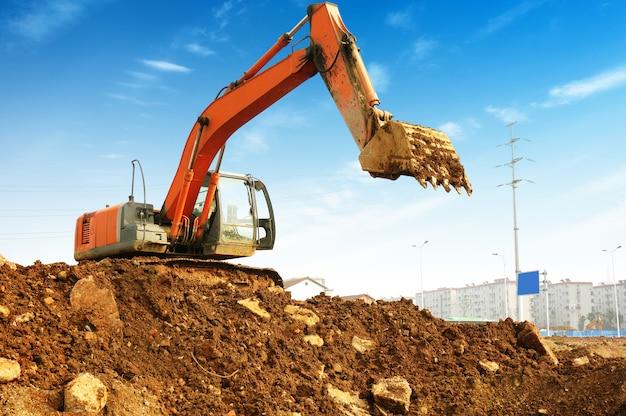 Yellow excavator on the site