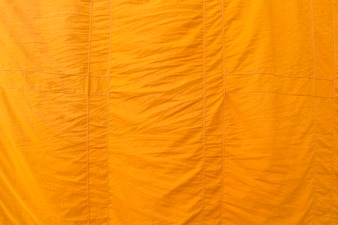 Yellow fabric texture background, Clergy robe in Buddhism