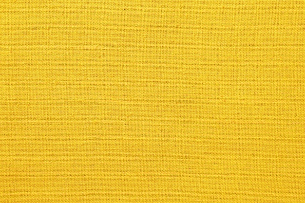 Yellow fabric texture background, pattern of natural textile.