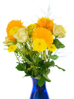 Yellow fall bouquet in blue vase close up isolated on white background