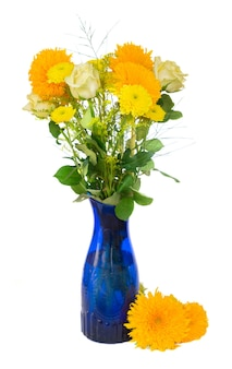 Yellow fall bouquet in blue vase isolated on white background